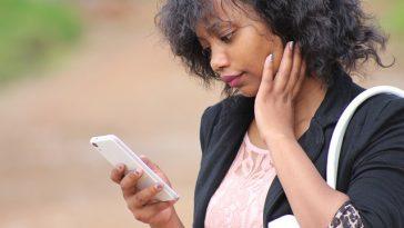 woman phone Faithfully Magazine app