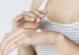 woman lotion hands