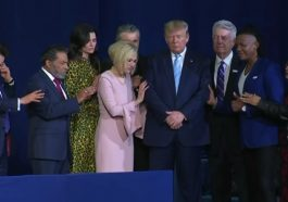 Evangelicals, including Paula White, Jentezen Franklin, Jack Graham, and Michael Tait of the Newsboys, surround and pray for President Donald Trump at King Jesus International church in Miami, Florida