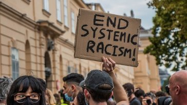 end systemic racism protest sign