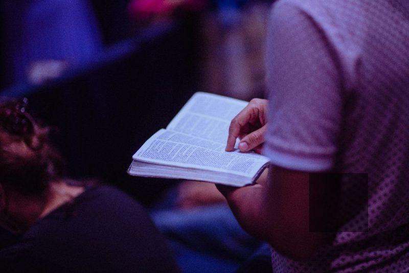 Man reading Bible church