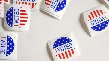 Voted printed papers on white surface