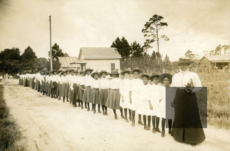 Mary McLeod Bethune stands with girls from her Literary and Industrial Training School for Negro Girls in Daytona, Florida, in this photo taken around 1905