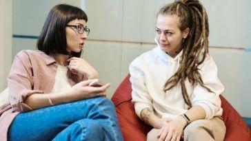 two women talk